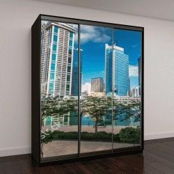 """Шкаф купе с фотопечатью """"Таймлапс, вид на небоскребы с набережной с пальмами"""""""