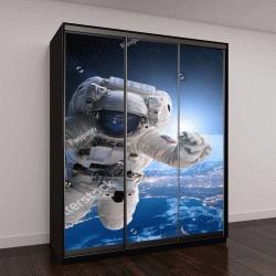 """Шкаф купе с фотопечатью """"Космонавт в космосе на фоне Земли"""""""