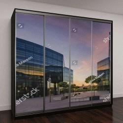 """Шкаф купе с фотопечатью """"Современное офисное здание на закате """""""