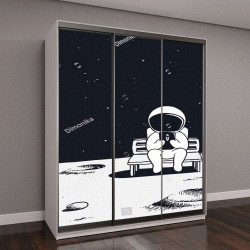 """Шкаф купе с фотопечатью """"космонавт сидит на скамейке и смотрит на мобильный телефон"""""""