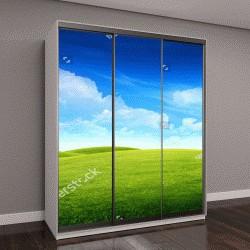 """Шкаф купе с фотопечатью """"Поле зеленой травы на небольших холмах и голубое небо с облаками"""""""