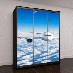 """Шкаф купе с фотопечатью """"пассажирский самолет, летящий высоко в небе над облаками"""""""