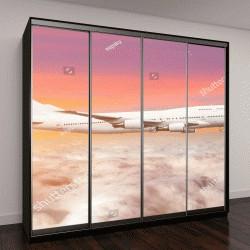 """Шкаф купе с фотопечатью """"Летающая ставка двухэтажный самолет над облаками горизонтом небо с яркий закат цвета"""""""