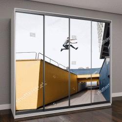 """Шкаф купе с фотопечатью """"парень прыгает между красочными зданиями в городе"""""""